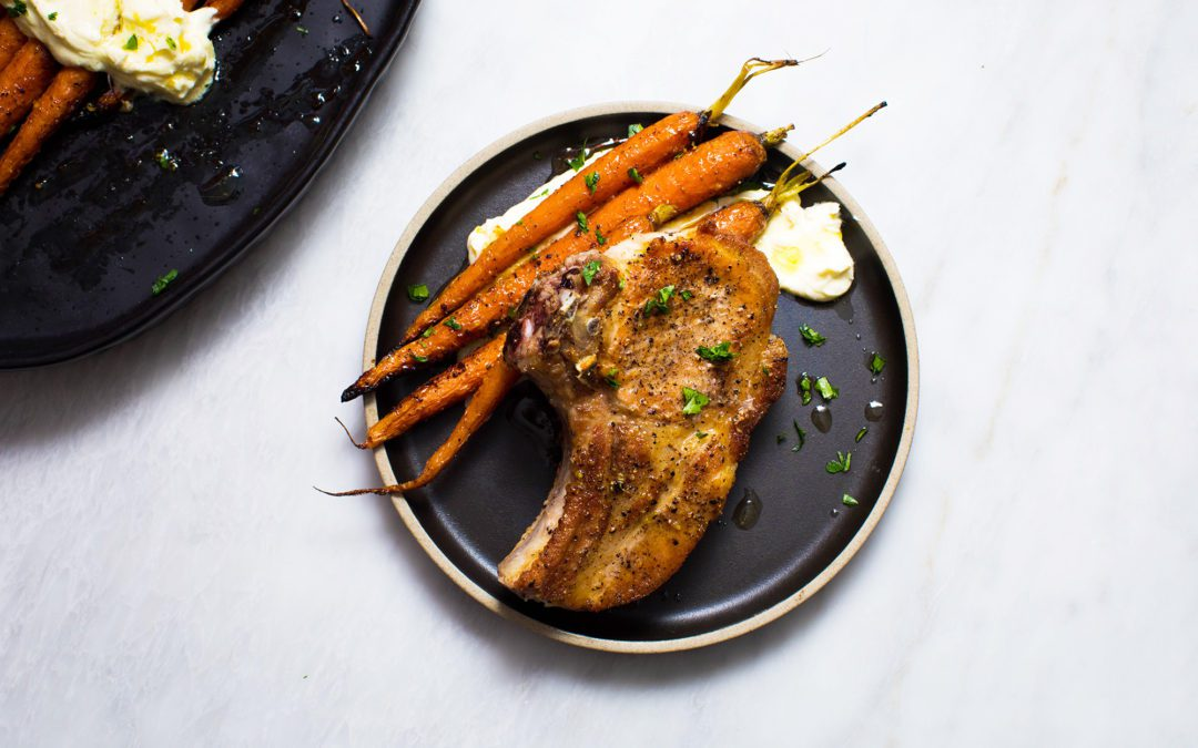 Bone-in Pork Chops with Harissa-Maple Roasted Carrots and Whipped Ricotta