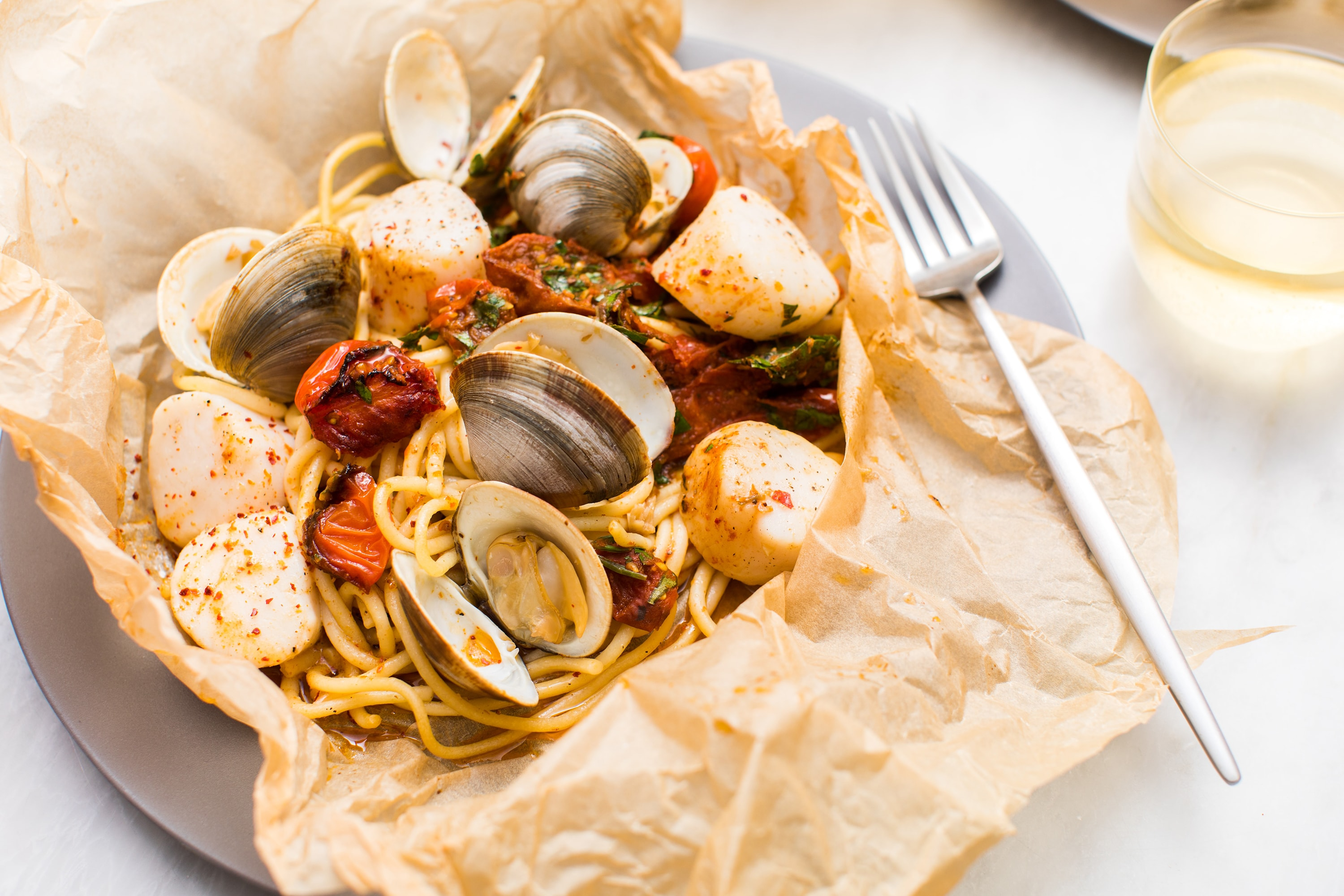 Easy Seafood Pasta In Parchment Paper Bags With Harissa Butter Tried Amp True Recipes