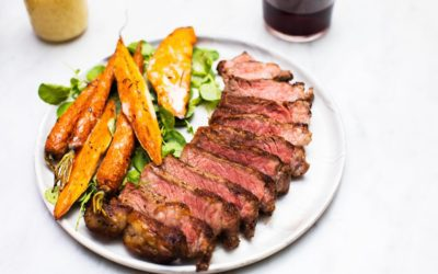 Seared New York Strip Served with Roasted Carrots and Sweet Potatoes and a Warm Maple-Cream Sauce